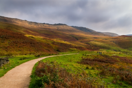 A family walking in beautiful peak district walk near Manchester, England photo