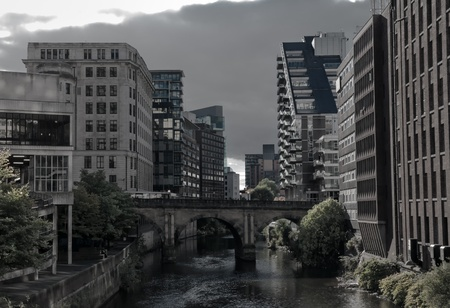 Manchester canal with modern buildings, apartments and office on both sides photo