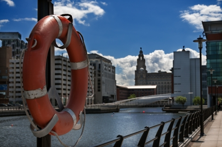 Life buoy in the foreground of liverpool dock