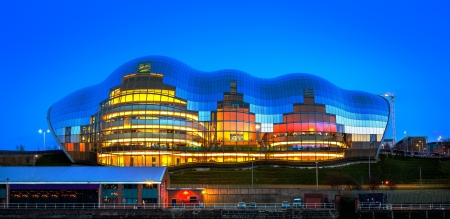 dockside: The Sage Gateshead is a centre for musical education, performance and conferences, located in Gateshead on the south bank of the River Tyne, in the North East of England