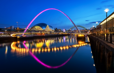 The Gateshead Millennium Bridge is a pedestrian and cyclist tilt bridge spanning the River Tyne in England between Gateshead s Quays arts quarter on the south bank, and the Quayside of Newcastle upon Tyne on the north bank  Stock Photo - 19489450