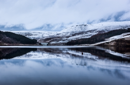 Snow on a hill at dovestone reservoir near Peak district photo
