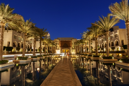 An arabian compound in Dubai line with palm trees