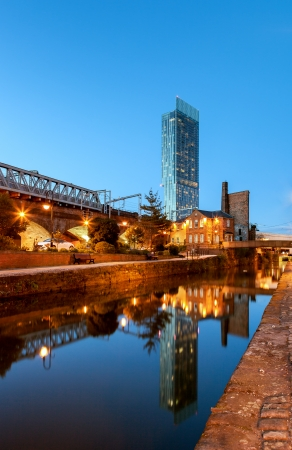 Beethom tower the tallest building in Manchester reflecting in canals of Manchester