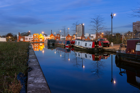 canal street: Boat houses moored in a canal in New islington A newly developed area in Manchester