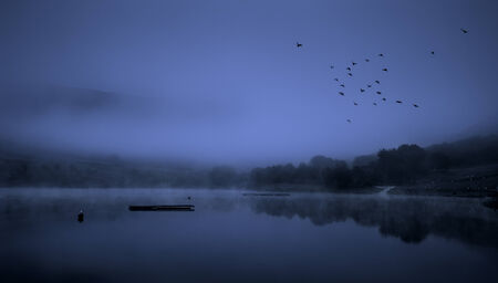 distric: Monochoromatic view of Dove Stone reservoir in the outskirts of Manchester England  Stock Photo