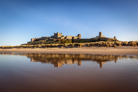 Bamburgh Castle is located on the coast at Bamburgh in Northumberland, England  photo