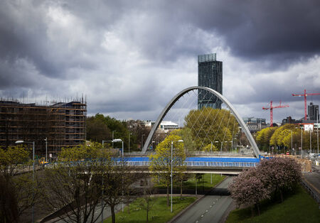 Hulme arch bridge and beetham tower viewed from Princess road which leads into Manchester city centre Stock Photo