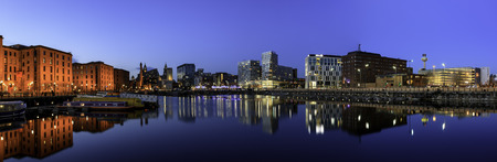 panoramic view of Liverpool skyline reflected in river mersy at albert dock