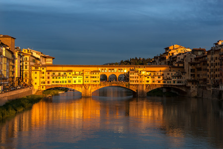 foot bridge: Ponte Vecchio the famous foot bridge in Florence Italy basking in evening golden sun light