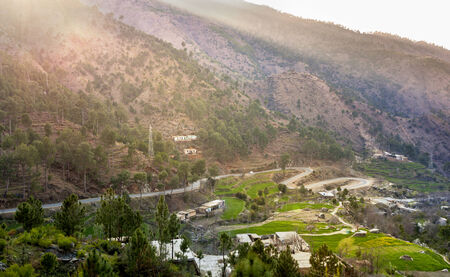 pakistan: A winding road passing through the mountains in Swat valley ,  Pakistan