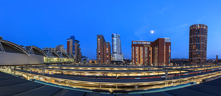 town centre: Leeds city skyline of modern architecture and rail tracks in the foreground, Leeds, England  Stock Photo