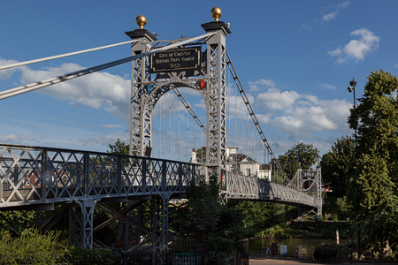 Queens Park suspension footbridge over the river Dee in Chester, England photo