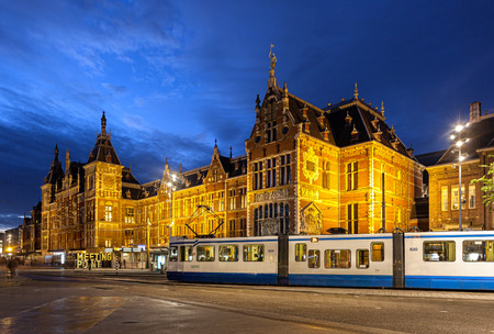 Amsterdam Centraal station is located in city centre of Amsterdam. Its buiilding is national heritage site, which is grand in style and very beautiful. Editorial