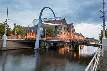 leeuwarden: This bascule style bridge is build over a canal in leeuwarden and a gateway to the town center of Leeuwarden Netherlands.