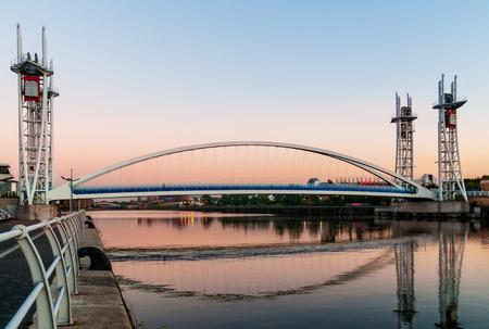 lowry: Millennium Bridge or the Lowry Bridge is a lift bridge provides pedestrian over the Manchester Ship Canal. Stock Photo