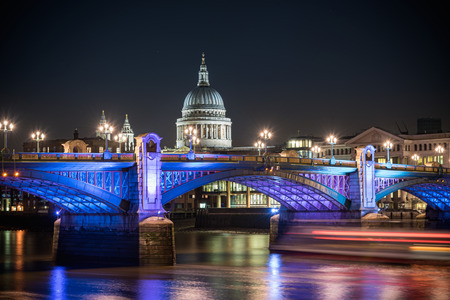 St Paul's Cathedral famous landmark of london poking behind Southwark bridge, London , England.