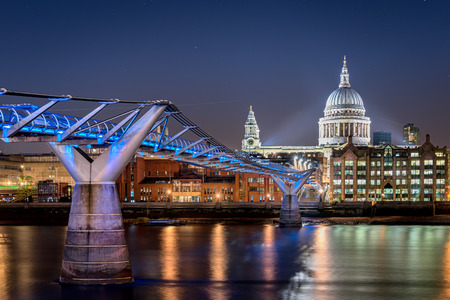 st pauls: Millennium bridge over river Thames and St Pauls cathedral are among the famous landmarks of London England. Stock Photo