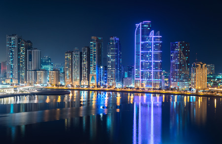 Skyline of Sharja and Dubai at night.
