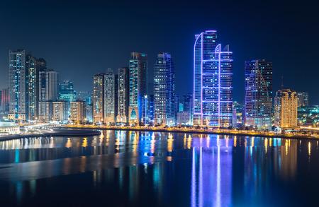 Skyline of Sharja and Dubai at night.