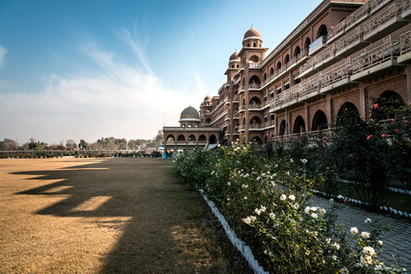 architectural style: New campus of university of Peshawar, Pakistan. Build in historic architectural style. Shadow of the building casting on the ground outlines the architecture.