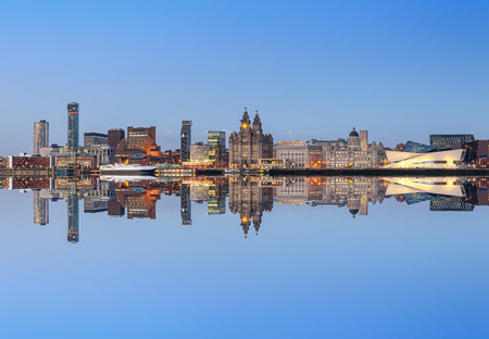liverpool: A perfect reflection of liverpool city skyline. All the famous landmarks of liverpool on the horizon.