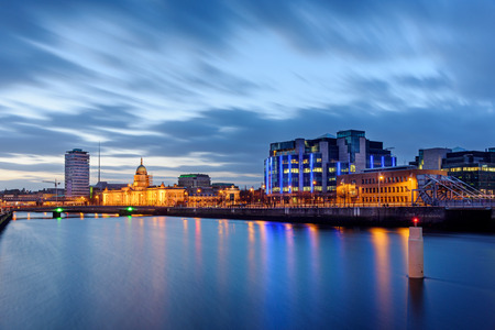 liffey: Panoramic view of Dubin skyline at twiight. Custom House on River Liffey. Stock Photo