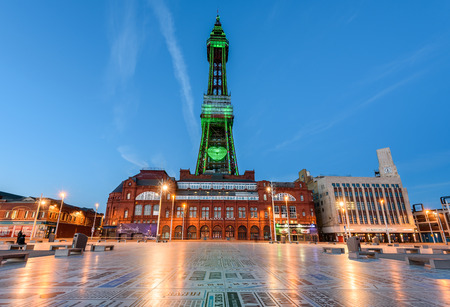 Blackpool tower a major attraction of Blackpool illuminated in green lights.