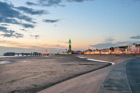 View of Blackpool tower, beach and the central pier from south shore. Stock Photo - 42561197