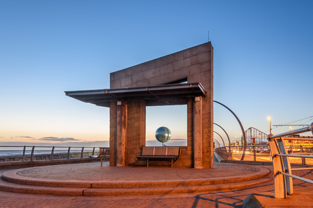promenade: View of a mirror ball through a seating shelter on the South shore of Blackpool promenade, UK