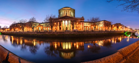 liffey: Building of four courts across river liffey in Dublin, Ireland. Stock Photo