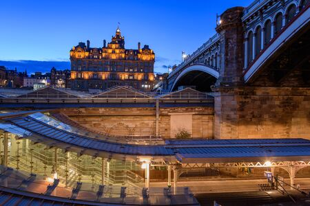 waverley: Ediburgh Waverley train station and old buildings at twilight.