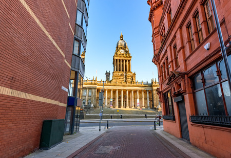 building exteriors: Leeds town hall viewed from the narrow streets of Leeds UK Editorial