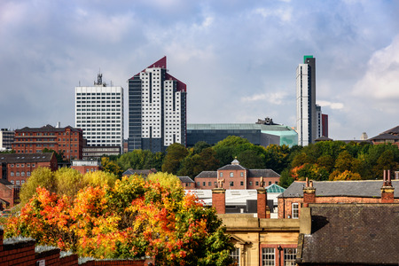 Skyline of Leeds city with old and new buildings in autumn.