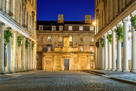 Cobbled streets of Bath city at night.