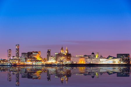 The Liverpool skyline from across Mersey river with all the major buildings such as liverpool museum, three graces, Royal Liver building, Port of Liverpool etc.