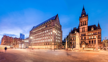 The old and new town hall buildings in the city centre of Manchester, England.