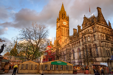Manchester town hall and father christmas at christmas market Albert Square, Manchester, England.
