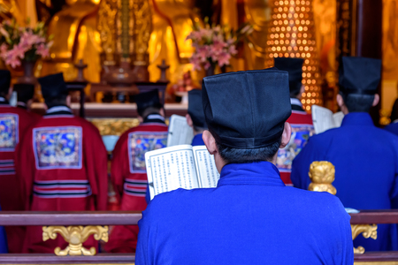 recitation: Chinese monks reciting the religious scripture in the temple.