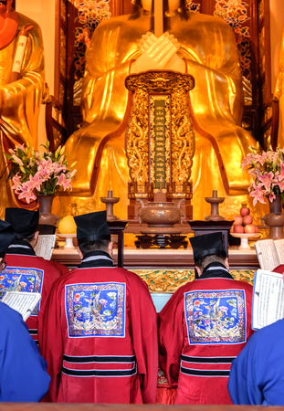 reciting: Chinese monks reciting the religious scripture in the temple.