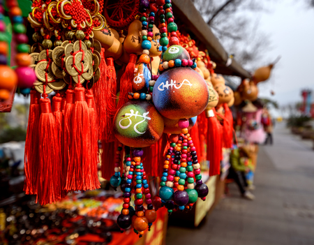 traditional goods: Chinese maket stall selling souveniers and traditional chinese decorative goods.