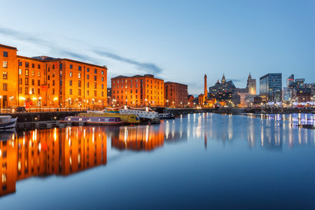 Reflections of old buildings at Albert Dock, Liverpool waterfront, UK.