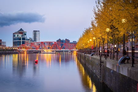 Red iron bridge at Salford Quays, Manchester, England. Stock Photo