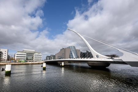 guild: Samuel Beckett Bridge is a cable-stayed bridge in Dublin that joins  River Liffey to Guild Street and North Wall Quay in the Docklands area.