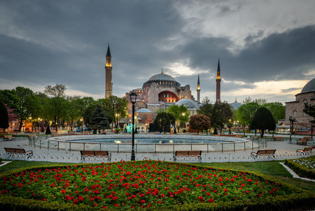 asian tulips: Hagia Sophia is seen behind tulips and fountain at Sultanahmet Square in Istanbul, Turkey