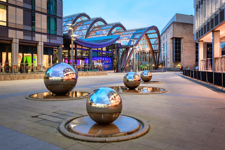 steel balls: Millennium Square is a modern city square in Sheffield, England. The steel balls in the square are water features Stock Photo