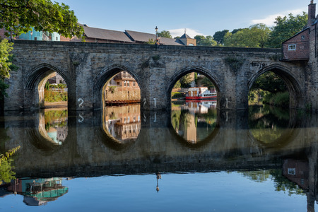 Old stone bridge crossing over River Wear running through the center of the Durham city, England.