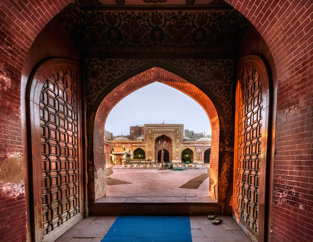 Entry into Wazir Khan Mosque is through a large Timurid-style Iwan over a smaller portal which faces the Wazir Khan Chowk.