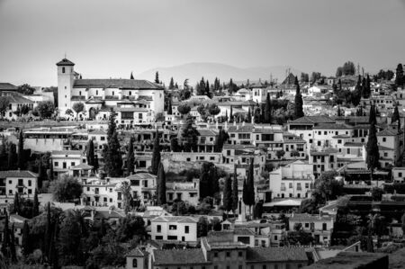 congested: White village on top of hill in Granada, Andalucia, Spain. Stock Photo