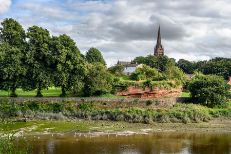 The River Dee is a river in the United Kingdom. It flows through parts of both Wales and England, forming part of the border between the two countries. Фото со стока
